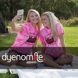 2 blondes pinicing in blue cutoofs and printed pink tie dye tees