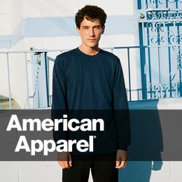 Male model in street scape wearing an American Apparel navy long sleeve top