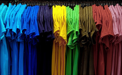 Blank t-shirts bunched together hanging in blocks of colours